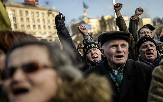 Anti-government protesters shout slogans at Independence Square, in Kiev, Ukraine, on Friday (photo credit: Bulent Kilic/AFP)