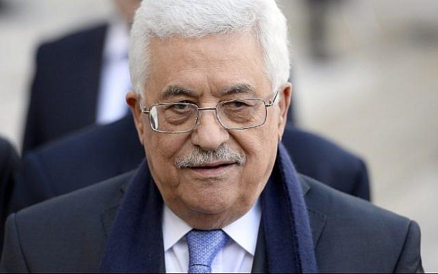 Palestinian Authority President Mahmoud Abbas arrrives at the Elysee Palace in Paris on February 21, 2014. (photo credit: Alain Jocard/AFP)