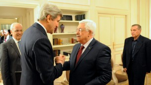 John Kerry, left, with Mahmoud Abbas in Paris on Wednesday, February 19. (photo credit: US State Department)