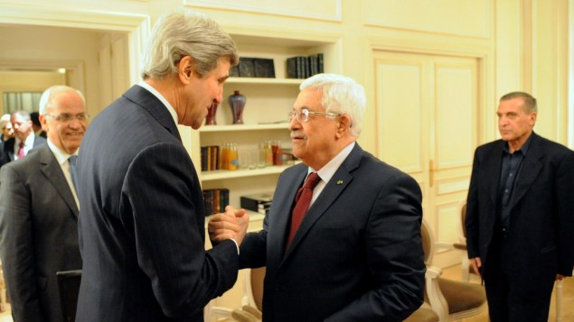 John Kerry, left, with Mahmoud Abbas in Paris on February 19 2014. (photo credit: US State Department)