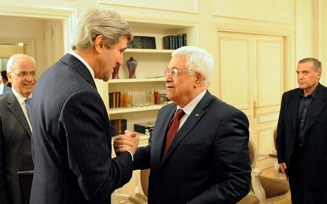 John Kerry, left, with Mahmoud Abbas in Paris, France, on February 19, 2014. (photo credit: US State Department)