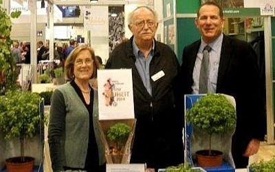 Yechezkel Dagan (C.), flanked by Hishtil executives Reut Rothman (L.) and Ronny Hasid (R.), present Hishtil's Basil Tree at IPM Essen (Photo credit: Courtesy)