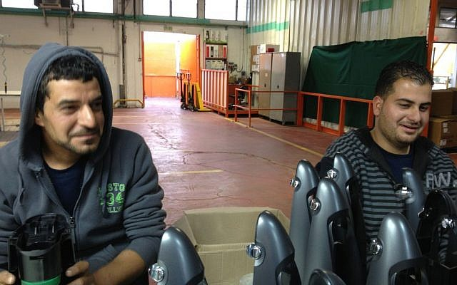 Palestinian employees at work on the SodaStream assembly line, February 2, 2014 (photo credit: Elhanan Miller/TOI)