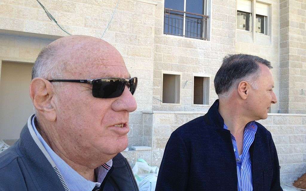Former Sharon adviser and current Rawabi legal fixer Dov Weisglass (left) stands next to Rawabi managing director Bashar Al-Masri (photo credit: Elhanan Miller/Times of Israel)