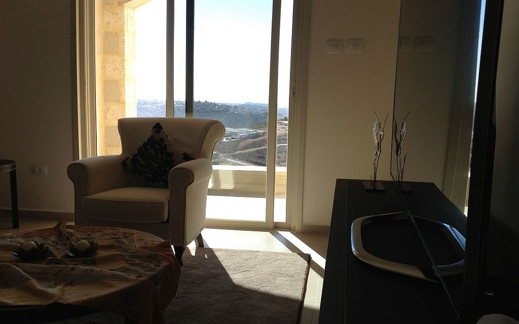 The living room in Rawabi's model apartment (photo credit: Elhanan Miller/Times of Israel)
