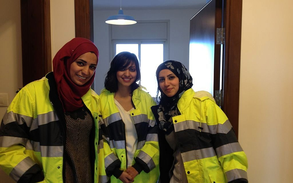 Civil engineer Shadia Jaradat (center) poses with two colleagues in one of Rawabi's model apartments. A third of the project's engineers are women (photo credit: Elhanan Miller/Times of Israel)