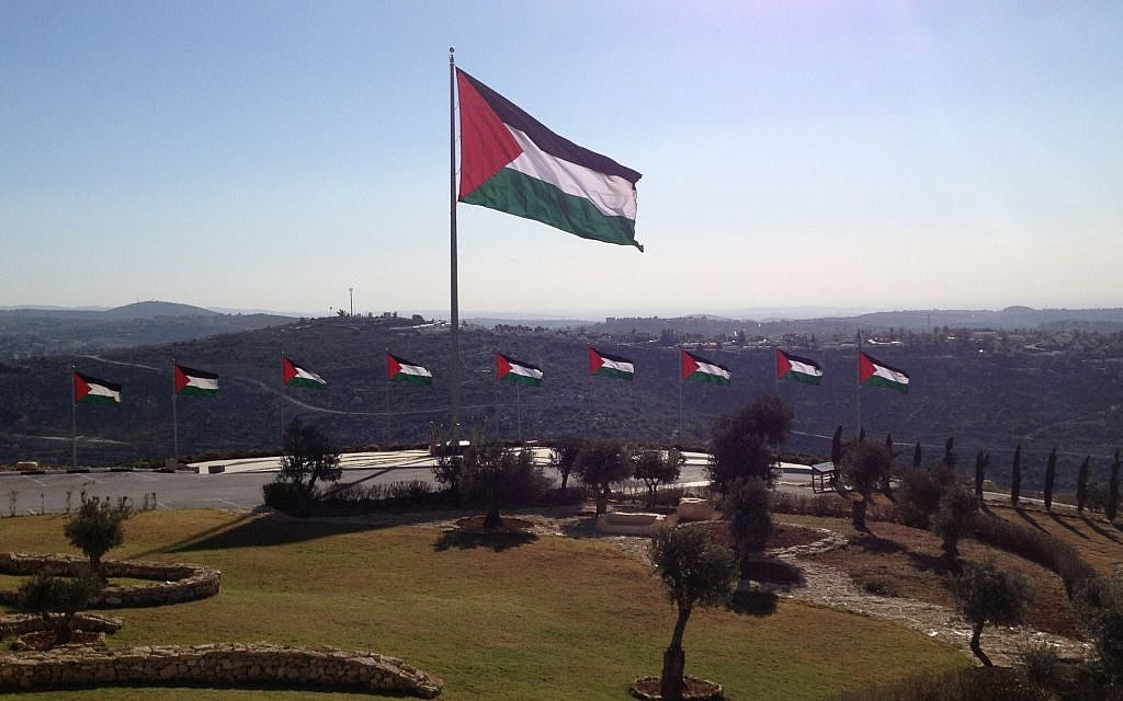 Palestinian flags encircle Rawabi's visitors' center (photo credit: Elhanan Miller/Times of Israel)