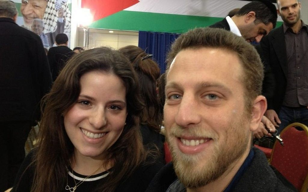 Israeli students Ehud Rotem, right, and Tal Tuchner await the speech of Mahmoud Abbas at the Muqataa in Ramallah, February 16, 2014 (photo credit: Elhanan Miller/Times of Israel)