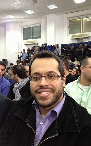 Beit Berl student Ophir Rosensaft awaits Abbas's speech at the Muqataa in Ramallah (photo credit: Elhanan Miller/Times of Israel)