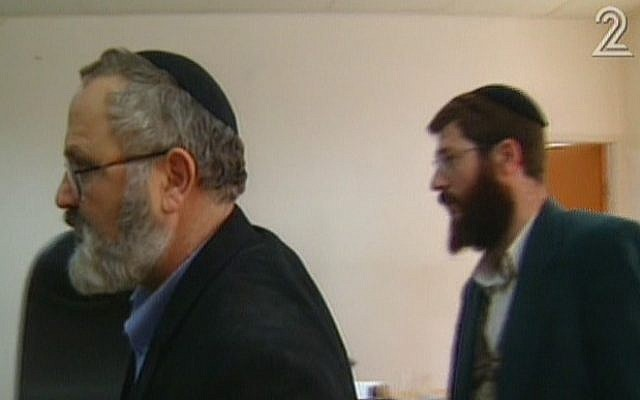 Eli Cohen, left, and Avihai Weinstein are suspected of selling arms to Iran. (screen capture: Channel 2)