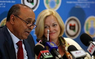 Libyan Foreign Affairs Minister Mohamed Abdelaziz (L) in Tripoli on February 4, 2014 (Photo credit: Mahmud Turkia/AFP)