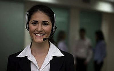 Customer service agent. She's smiling, but what about the customer? (Photo credit: Courtesy)