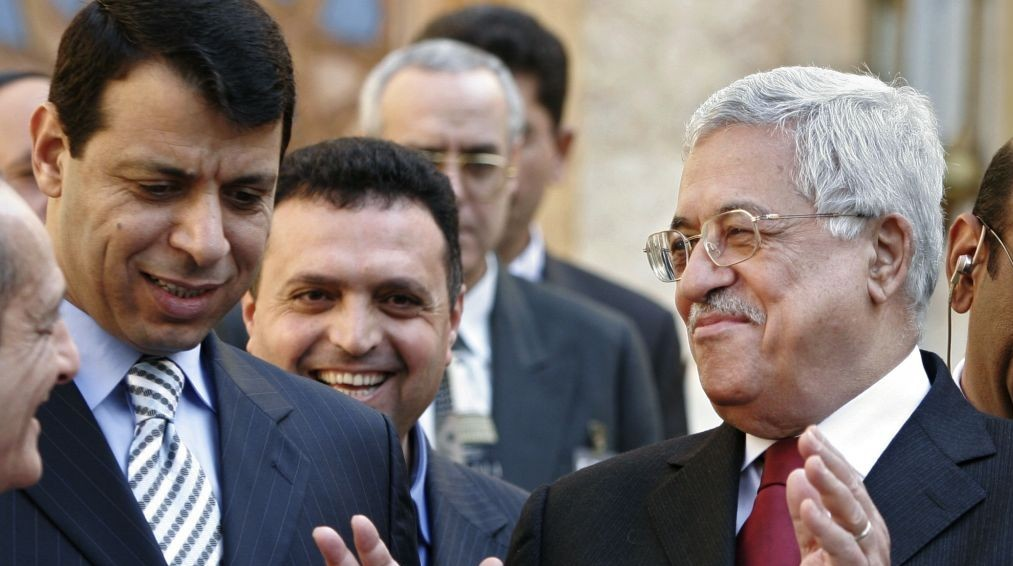 Palestinian Authority President Mahmoud Abbas, right, and Mohammad Dahlan, left, leave a news conference in Egypt, in February 2007. (AP/Amr Nabil)