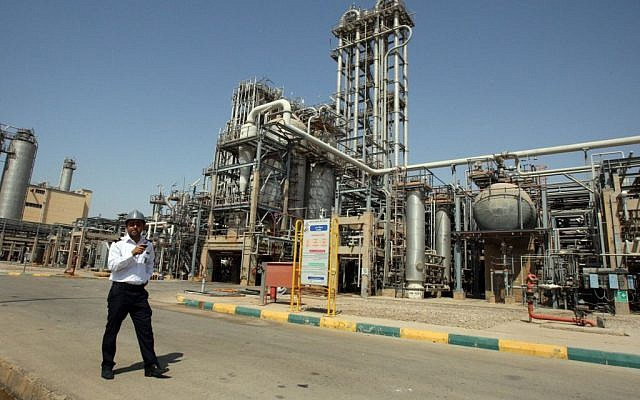 An Iranian security guard stands at the Maroun petrochemical plant at the Imam Khomeini port, southwestern Iran. (AP/Vahid Salemi, File)