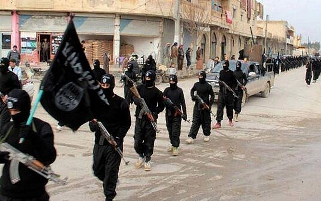 This undated file image posted on a militant website on Tuesday, Jan. 14, 2014, shows fighters from the al-Qaeda linked Islamic State of Iraq and the Levant (ISIS) marching in Syria (photo credit: AP)