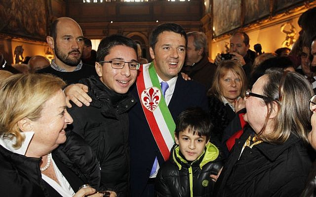 Florence mayor Matteo Renzi greets couples that have been married for over 50 years during a ceremony on Valentine's Day in Florence, Italy, Friday, Feb. 14, 2014.  (photo credit: AP Photo/Fabrizio Giovannozzi)