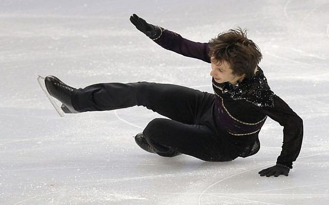 Alexei Bychenko falls on his quad attempt during the men's free skate at the 2014 Olympic Winter Games in Sochi, Russia, on Friday (photo credit: AP/Vadim Ghirda)