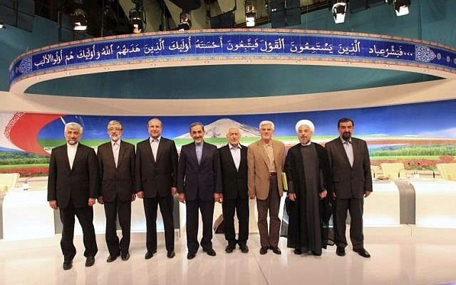 In this photo released by the Islamic Republic of Iran Broadcasting (IRIB), May 31, 2013, then presidential candidates from left, Saeed Jalili, Gholam Ali Haddad Adel, Mohammad Bagher Qalibaf, Ali Akbar Velayati, Mohammad Gharazi, Mohammad Reza Aref, Hassan Rouhani, Mohsen Rezaei, pose for a group picture, after their TV debate in a state-run TV studio, in Tehran. (photo credit: AP Photo/Islamic Republic of Iran Broadcasting, Mehdi Dehghan)
