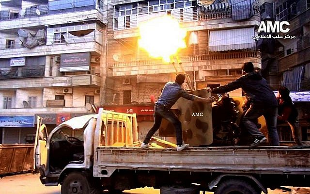 Rebels fire their anti-aircraft gun at Syrian army airplanes in Aleppo, Syria, Saturday Feb. 1, 2014.  (photo credit: AP/Aleppo Media Center, AMC)