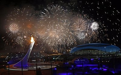 Fireworks are seen over the Olympic Park during the opening ceremony of the 2014 Winter Olympics in Sochi, Russia, Friday, Feb. 7, 2014. (photo credit: AP/Julio Cortez)