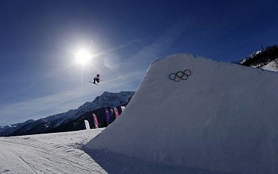 Britain's James Woods takes a jump during ski slopestyle training at the Rosa Khutor Extreme Park ahead of the 2014 Winter Olympics, Friday, Feb. 7, 2014, in Krasnaya Polyana, Russia. (photo credit: AP Photo/Sergei Grits)
