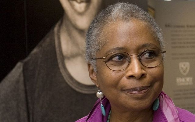 In this April 23, 2009 file photo, Alice Walker stands in front of a picture of herself from 1974 as she tours her archives at Emory University, in Atlanta. (AP Photo/John Amis)