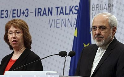 European Union High Representative Catherine Ashton and Iranian Foreign Minister Mohammad Javad Zarif, from left, speak to press after closed-door nuclear talks in Vienna, Austria, on Thursday, February 20, 2014. (photo credit: AP Photo/Ronald Zak)