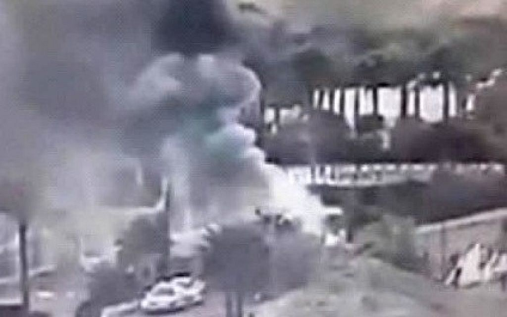 An image made from a video provided by the Israeli Airports Authority shows smoke from the bombing of the bus carrying South Korean sightseers near the tip of the Red Sea's Gulf of Aqaba Sunday Feb. 16, 2014.(photo credit: AP Photo/Israeli Airports Authority)