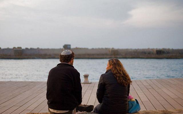 A Modern Orthodox couple with a sea view (Illustrative photo credit: Dima Vazinovich/Flash90)