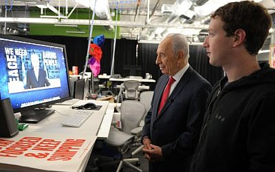 President Shimon Peres with Facebook founder Mark Zuckerberg in March 2012 (photo credit: Moshe Milner/ GPO/ Flash 90)
