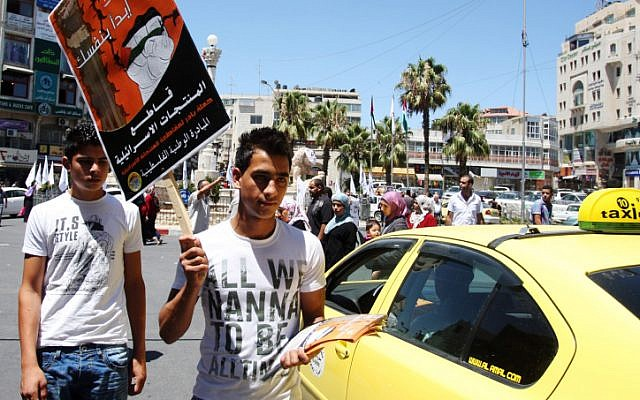 Palestinians protesters call for a boycott of Israeli products (illustrative photo: Issam Rimawi/Flash90)