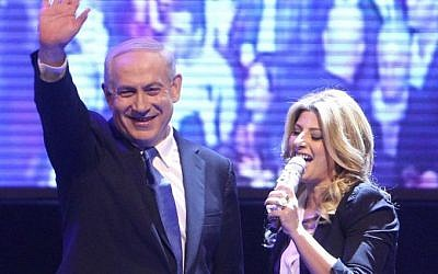 Prime Minister Benjamin Netanyahu with Israeli singer Sarit Haddad, as Netanyahu and leader of the Israel Beiteinu party Avigdor Liberman, present their joint campaign prior to the Israeli elections, in Jerusalem on December 25, 2012. (Photo credit: Miriam Alster/FLASH90)