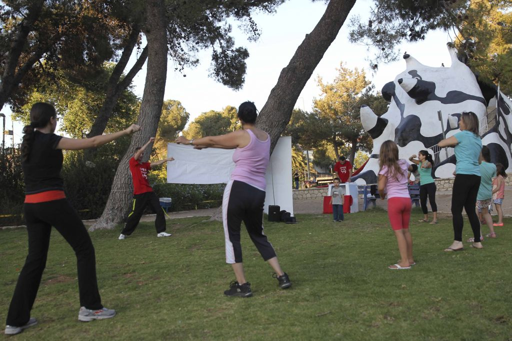 Practicing Zumba on the green, shady expanses of Kiryat Hayovel's 'Monster Park,' which is likely to be destroyed for the light rail project (photo credit: Nati Shochat/Flash 90)