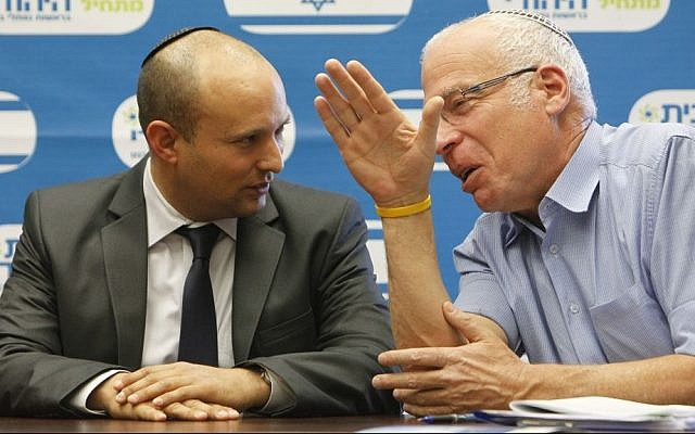 Naftali Bennett (L), leader of the Jewish Home party, seen with Jewish Home MK Uri Ariel at a faction meeting in the Knesset on October 28, 2013. (photo credit: Miriam Alster/Flash90)