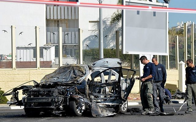 The aftermath of a car bombing in Rehovot, December 23, 2013 (photo credit: Yossi Zeliger/Flash90)