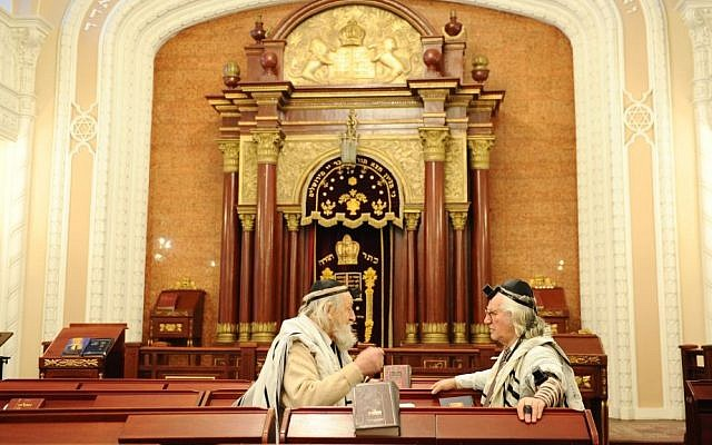 Illustrative photo of Jewish men inside a synagogue in Kiev (Mendy Hechtman/Flash90)