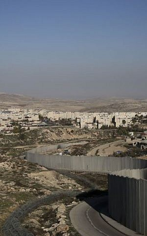 The security barrier separates the Shuafat refugee camp on the right from the Jewish neighborhood of Pisgat Zeev (photo credit: Hadas Parush/Flash90)