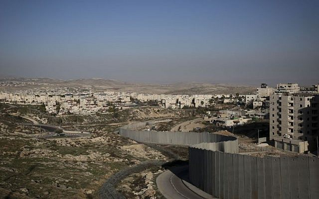 The security barrier that separates East Jerusalem's Shuafat refugee camp, on the right, from the Jewish neighborhood of Pisgat Ze'ev. (Hadas Parush/Flash90)