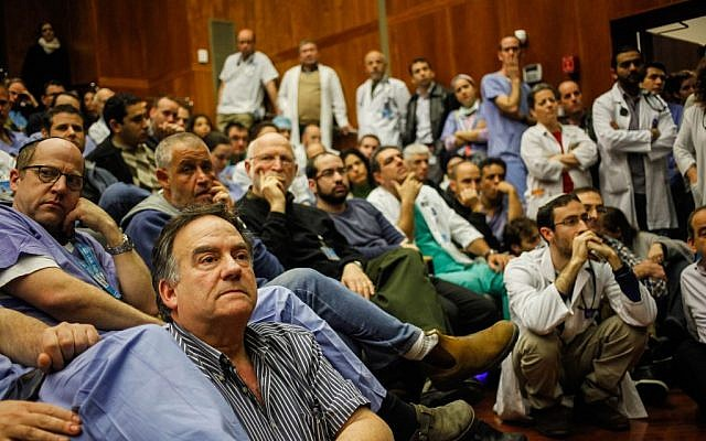 Israeli doctors seen during an emergency meeting at Jerusalem's Hadassah Ein-Kerem Hospital on February 4, 2014 (photo credit: Flash90)