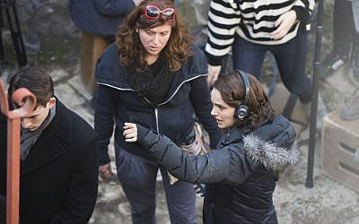 Natalie Portman (R) in Jerusalem's Nahlaot neighborhood directing a scene from 'A Tale of Love and Darkness,' February 11, 2014. (Yonatan Sindel/Flash 90)