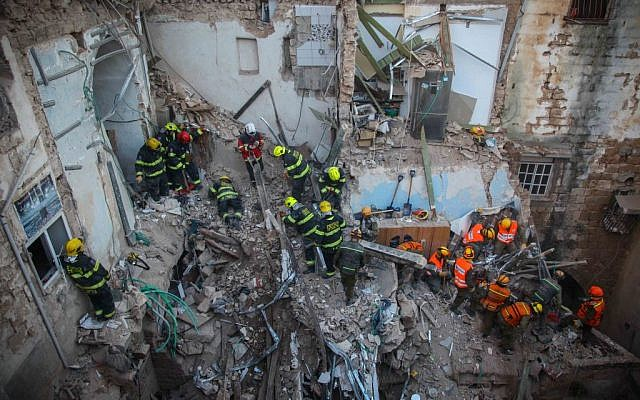 Rescue personnel at the scene of an explosion that killed five and injured 11 in the northern city of Acre, Monday, February 17, 2014 (photo credit: Avishag Shaar Yashuv/Flash90)