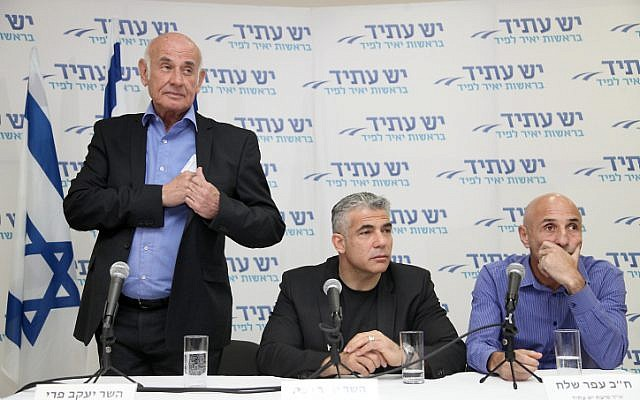 Leader of Yesh Atid political party Yair Lapid (center), MK Yaakov Perry and Ofer Shelah seen at a press conference in Tel Aviv on February 20, 2014. (photo credit: Gideon Markowicz/Flash90)