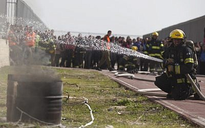 Firefighters participating in an IDF Home Front Command drill on February 24 (photo credit: Flash 90)