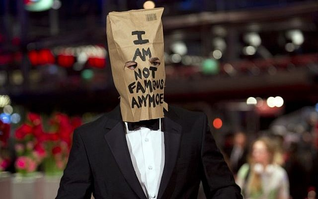 Actor Shia LaBeouf poses for photographers, with a paper bag over his head that says 'I am not famous anymore,' on the red carpet for the film 'Nymphomaniac' at the International Film Festival Berlinale in Berlin, on February 9, 2014. (photo credit: AP/Axel Schmidt)