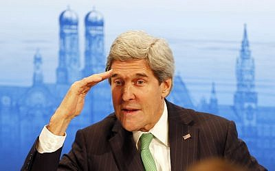 US Secretary of Foreign Affairs John Kerry salutes as he attends the 50th Security Conference in Munich, Germany, Saturday, Feb. 1, 2014. The conference on security policy takes place from Jan. 31, 2014 until Feb. 2, 2014. (photo credit: AP/Frank Augstein)