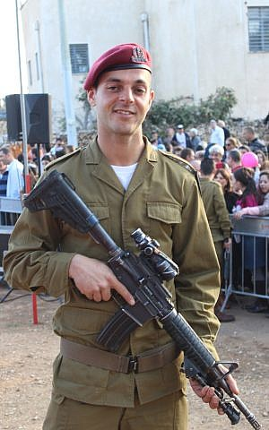 Having just received the red beret that signifies the completion of his training, Private Isaac Moyal, 29, who was born in France and grew up in England, is the oldest person to ever join the IDF's Paratroopers Brigade. (The Times of Israel/Rebecca McKinsey)