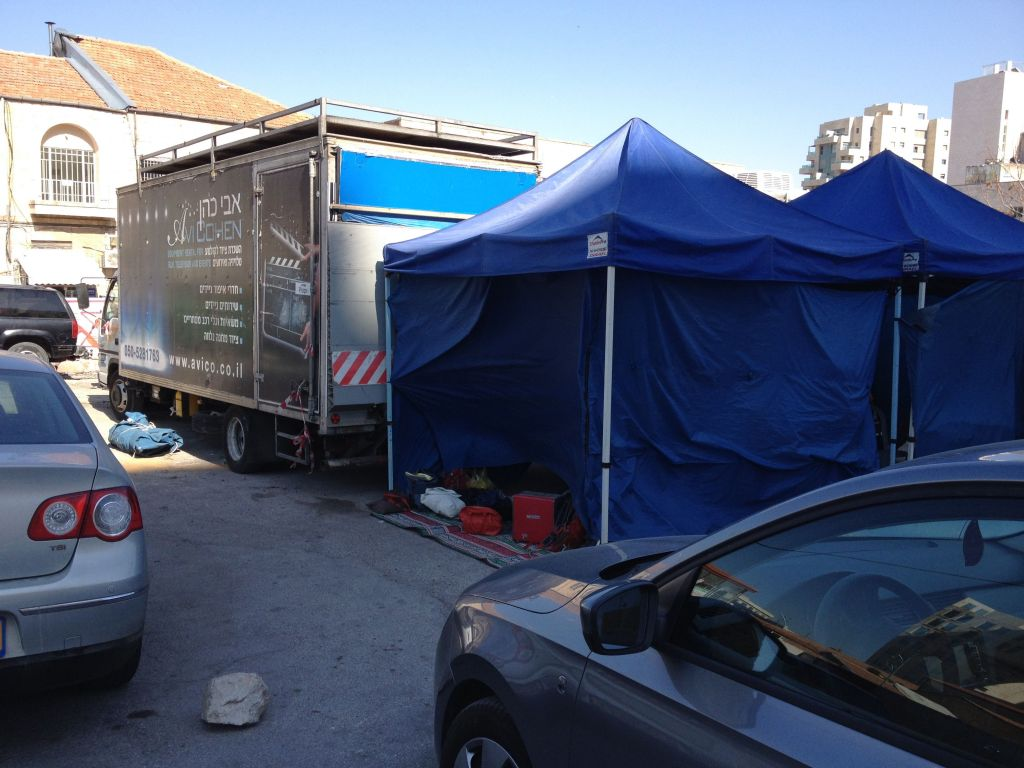 Trailers, tents and catering trucks parked at the Eliash lot (photo credit: Jessica Steinberg/Times of Israel)