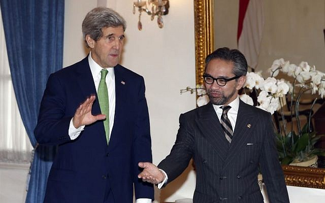 US Secretary of State John Kerry, left, is ushered by Indonesian Foreign Minister Marty Natalegawa before a meeting at the Foreign Ministry office in Jakarta, Indonesia, Monday, Feb. 17, 2014. (photo credit: AP/Adi Weda, Pool)