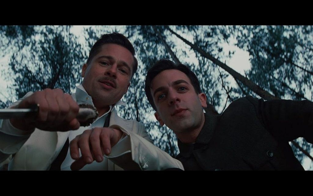 "Brad Pitt, left, and B.J. Novak in ""Inglourious Basterds."" Pitt plays a non-Jewish American soldier who leads a group of Jewish soldiers that hunt down Nazis during World War II (photo credit: Courtesy)"