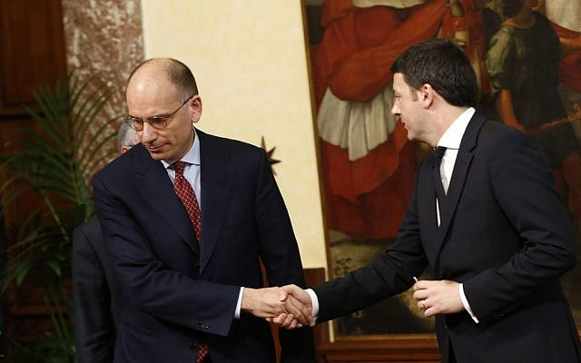 Italian outgoing Premier Enrico Letta, left, shakes hands with new Premier Matteo Renzi as he leaves after handing him over the cabinet minister bell during the handover ceremony at Chigi Palace Premier's office, in Rome, Saturday, Feb. 22, 2014. (photo credit: AP/Riccardo De Luca)